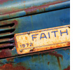 Faith License plate on front of a rusty car